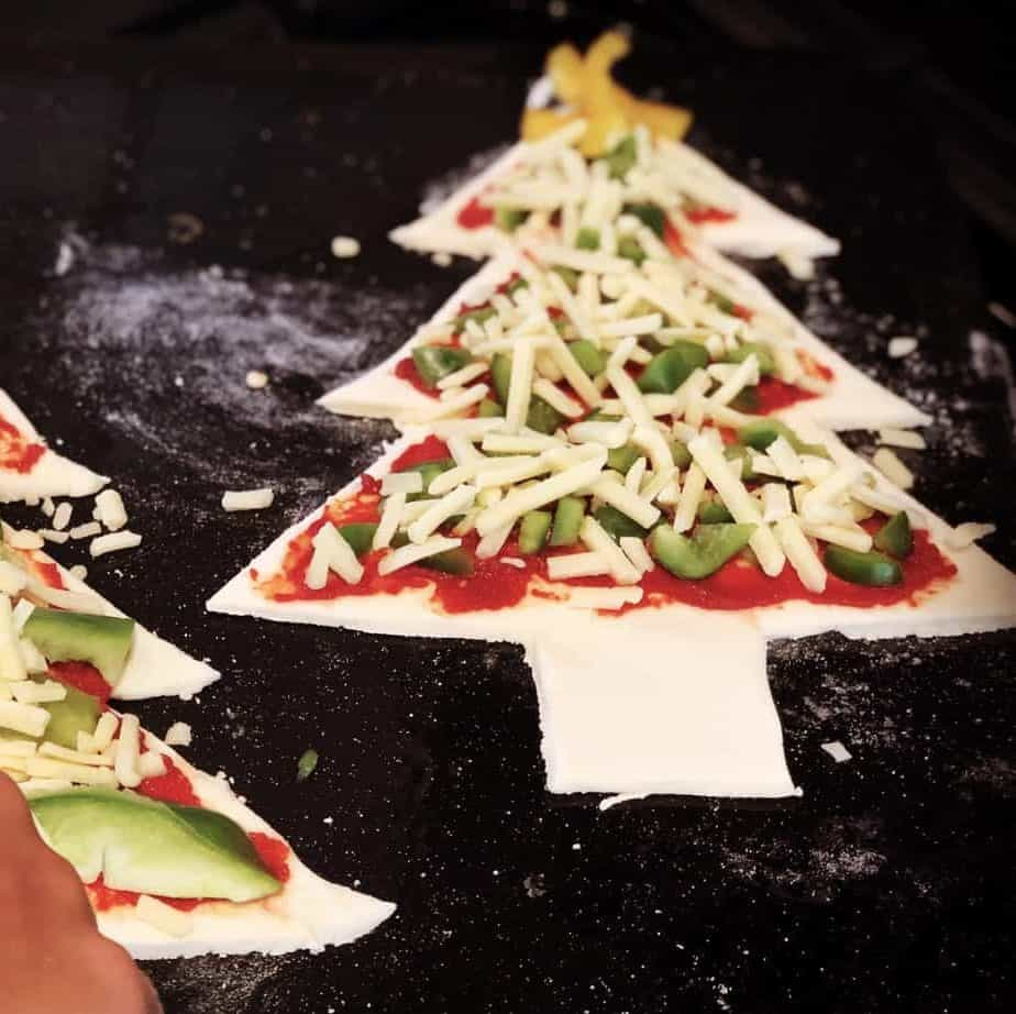 Easy Christmas Tree Pizza Recipe & Free printable templates to make homemade Christmas Tree & Christmas Star Pizzas from the International Elf Service
