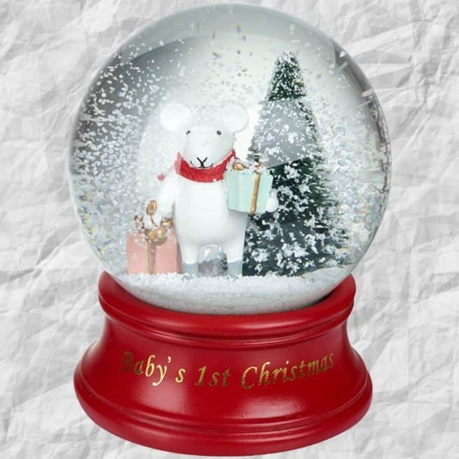 A magical and enchanting Baby's First Christmas Snow Globe keepsake from International Elf Service.