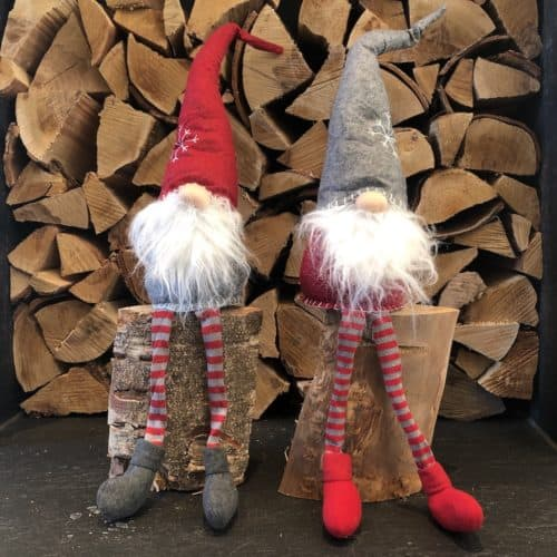 Sitting Christmas Elves from International Elf Service. Sold individually. Choose from a Christmas Elf with a red hat, or an Elf with a grey hat.