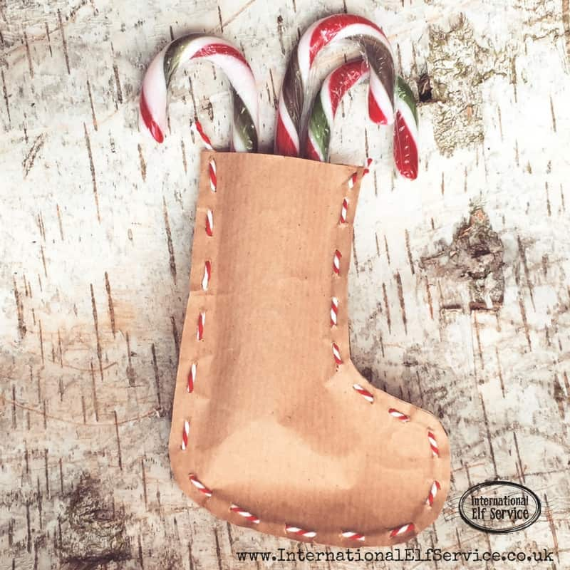 Wonderful Christmas Activity: How to make the cutest brown paper Christmas stockings to stuff with treats and pop into their Christmas stockings!
