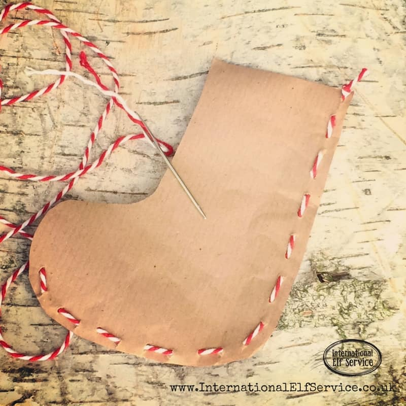 How to make the cutest brown paper Christmas stockings to stuff with treats and pop into their Christmas stockings!