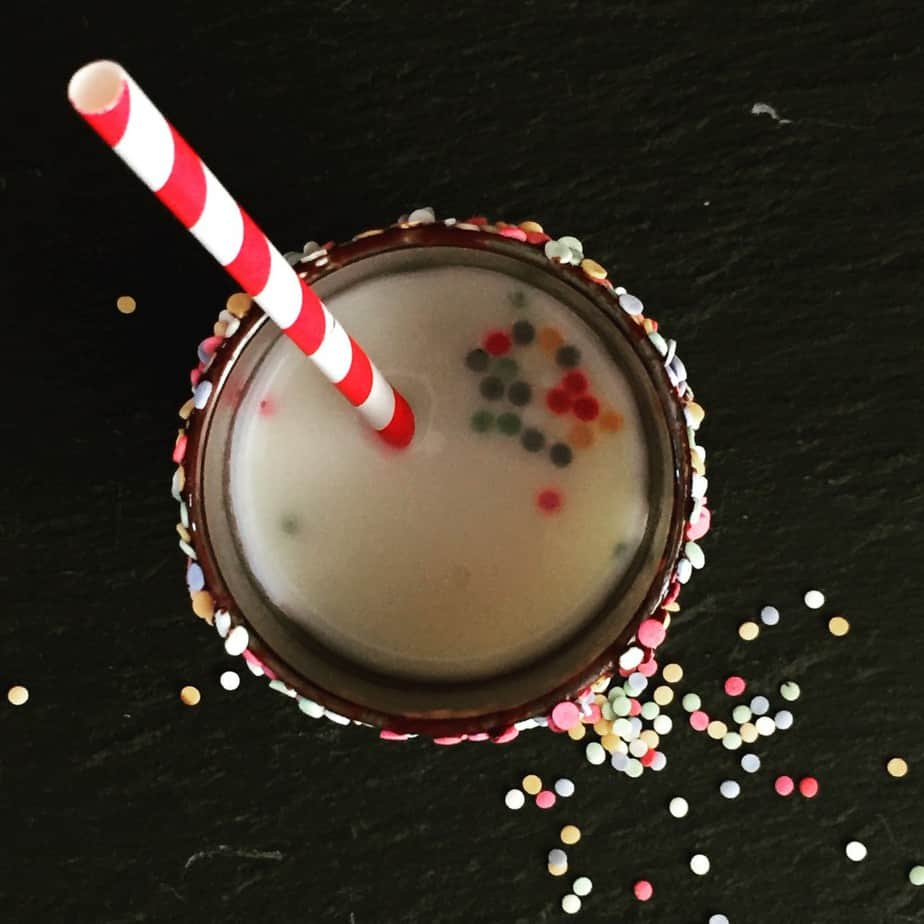 How to make Christmas Eve extra magical. Candy cane milk with sprinkles - perfect for Christmas Eve or a North pole breakfast!
