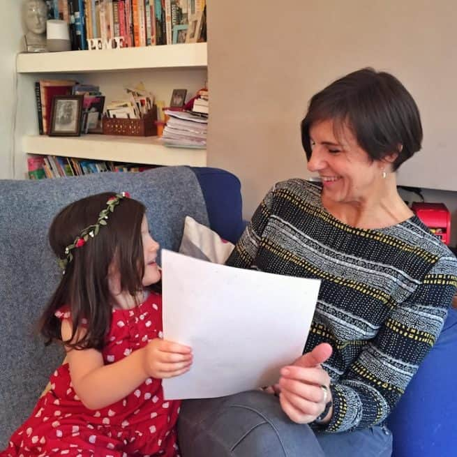 mum and daughter reading an Elf Letter from the international Elf Service. Elfie's Christmas Letters and the North Pole Christmas letters are new each year!